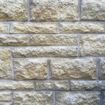 BUFF PITCHED ANSTONE WALLING